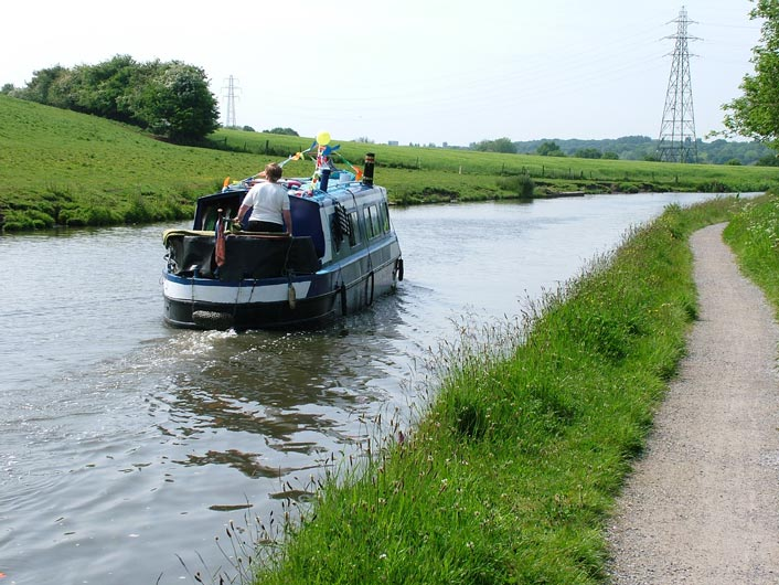 A narrow boat passes us at Daresbury