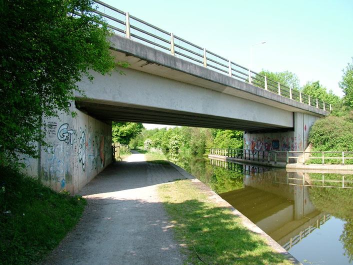 A nondescript modern bridge with graffiti