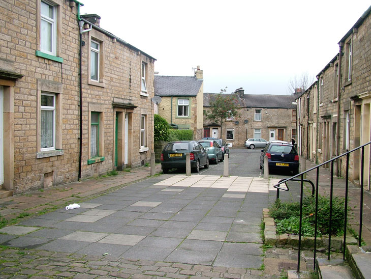 A stone terraced street by the canal