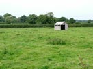 A lone shed in a field